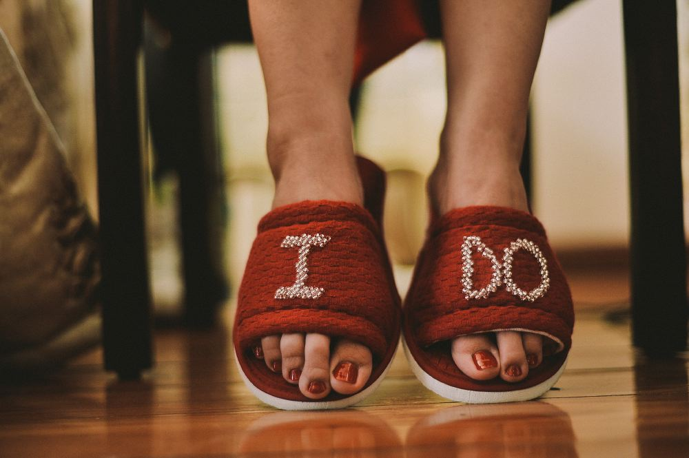 san   diego wedding photographer | woman wearing slippers that say I do