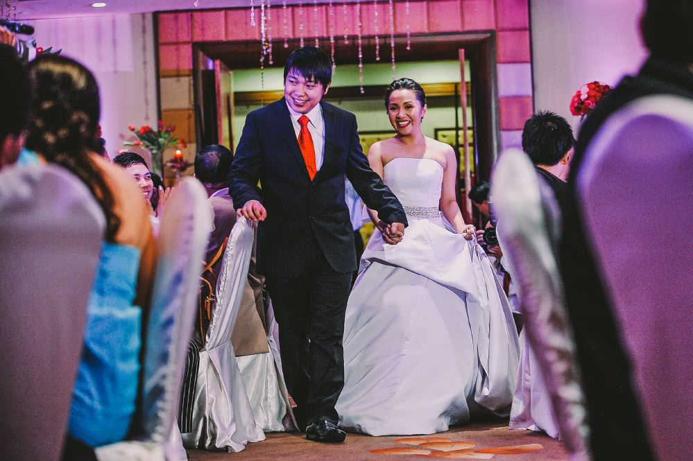 san   diego wedding photographer | bride and groom walking between tables of   reception area