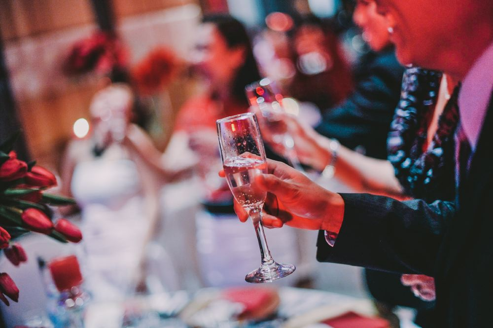san   diego wedding photographer | shot of torso of man holding up champagne glass