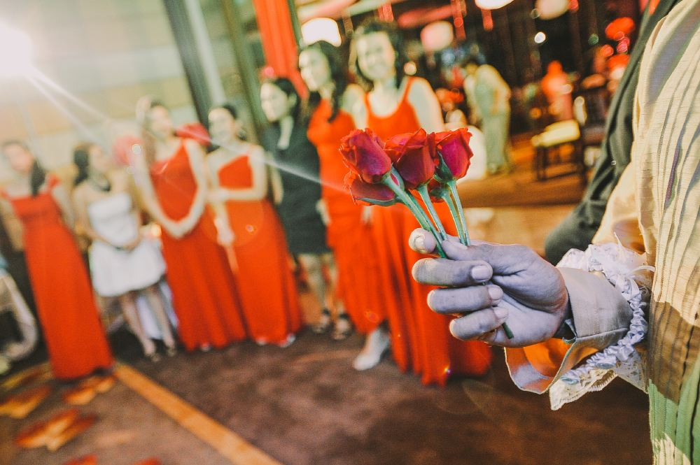 san   diego wedding photographer | closeup shot of person holding bundle of red   roses