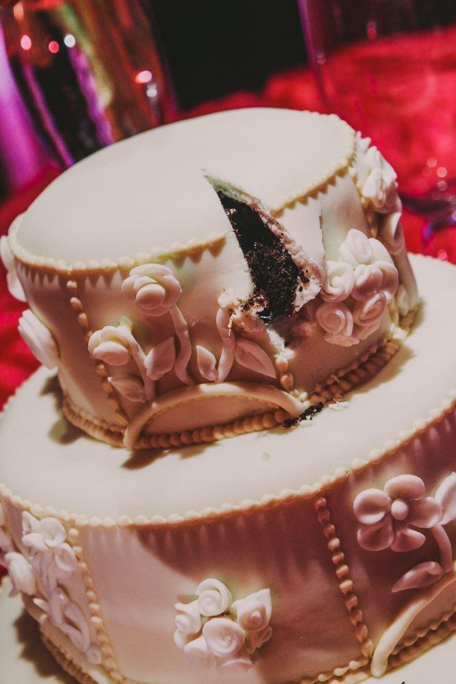 san   diego wedding photographer | wedding cake with a slice taken out