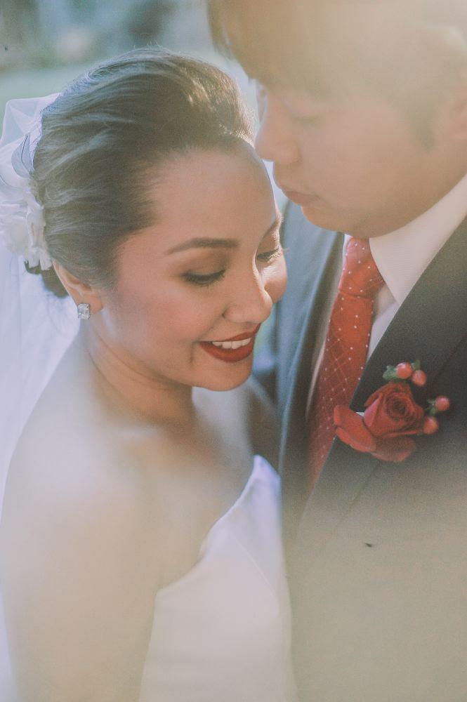 san   diego wedding photographer | close shot of man holding bride close slightly   exposed