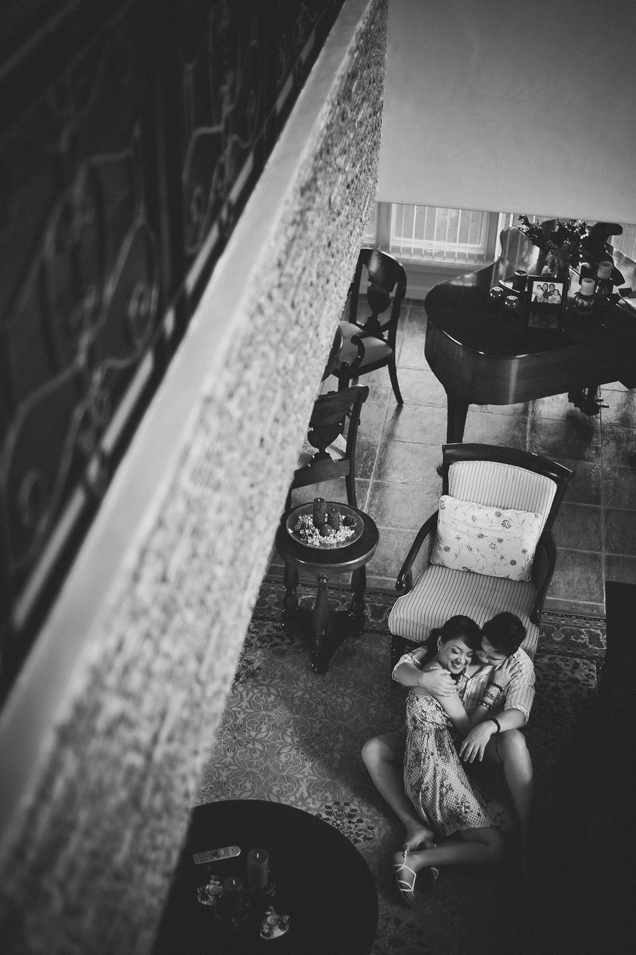 san   diego wedding photographer   monotone shot of man and woman sitting on rug   with piano in background