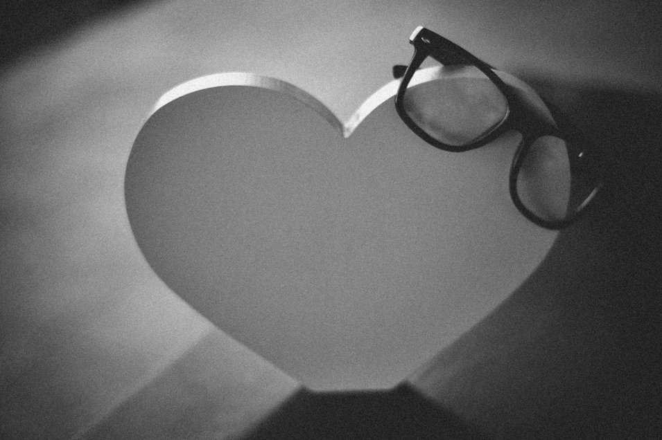 san   diego wedding photographer   monotone shot of heart with glasses on top