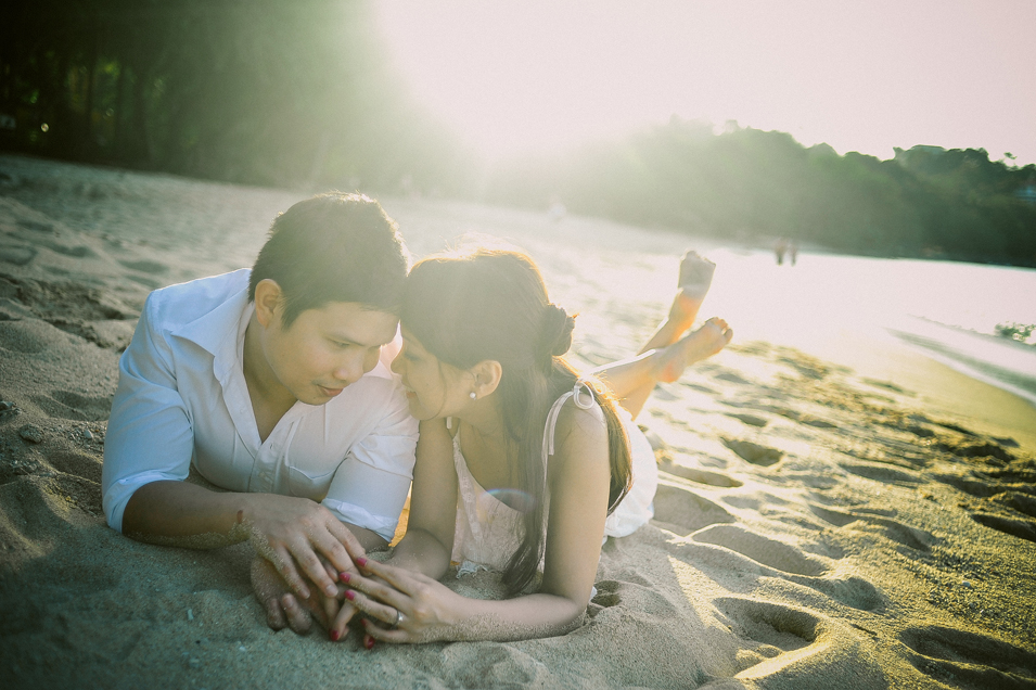 san   diego wedding photographer   man and woman lying down on sand