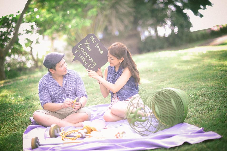 san   diego wedding photographer   man and woman sitting on blanket on grassy floor