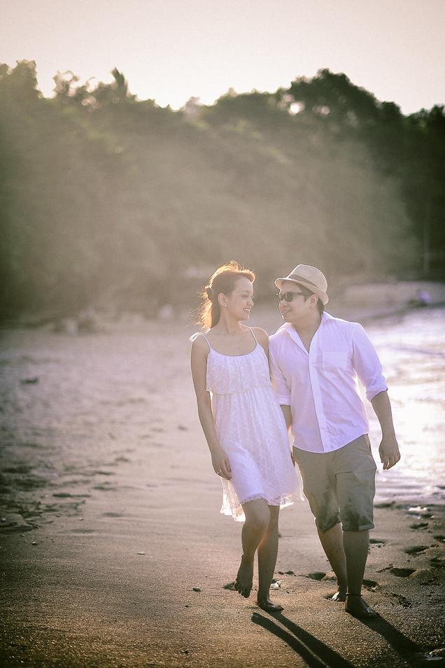 san   diego wedding photographer   man and woman in white walking along beach shore