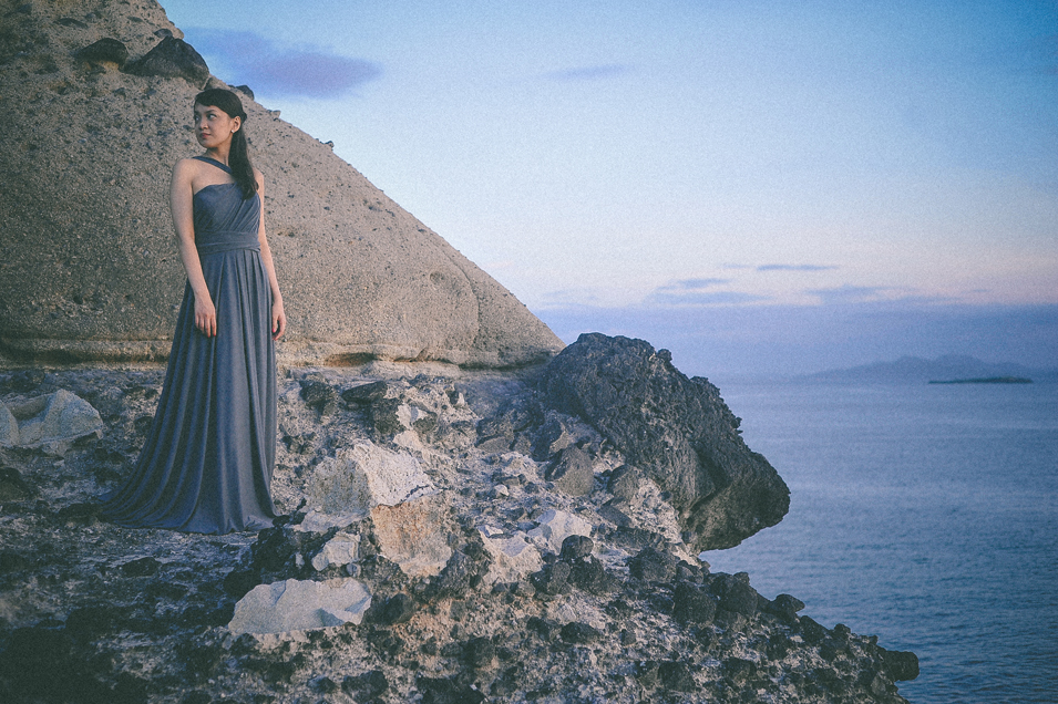 san   diego wedding photographer   woman in dress on top of picturesque rocky shore