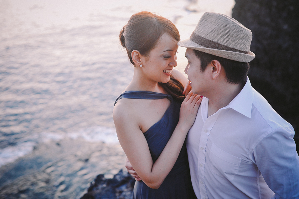 san   diego wedding photographer   close shot of man holding woman close on rocky   shore