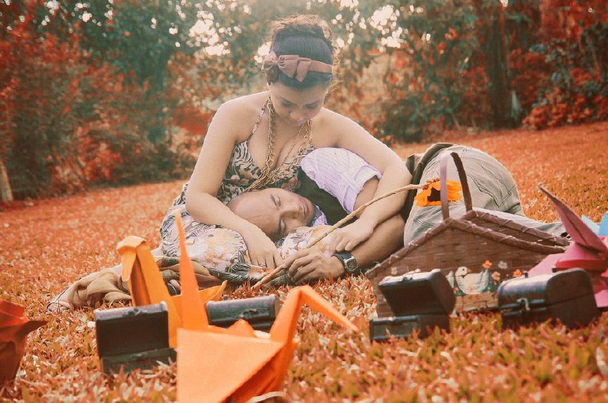 san   diego wedding photographer | man lying on grass with woman holding him