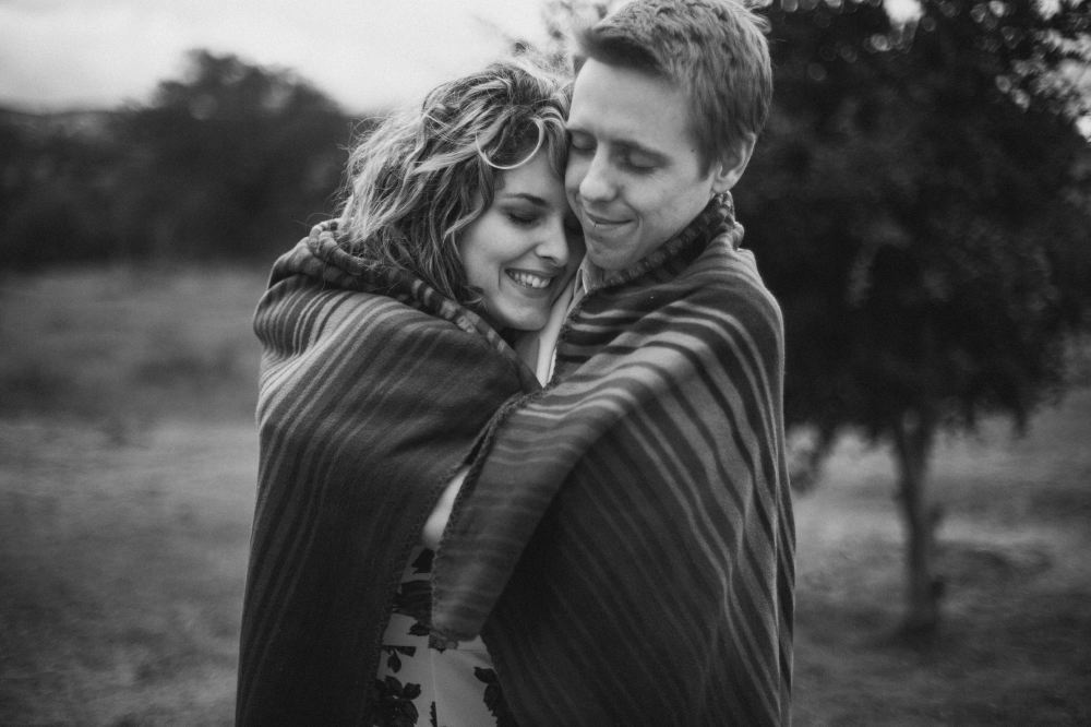 san   diego wedding photographer | monotone shot of couple with blanket around them   hugging