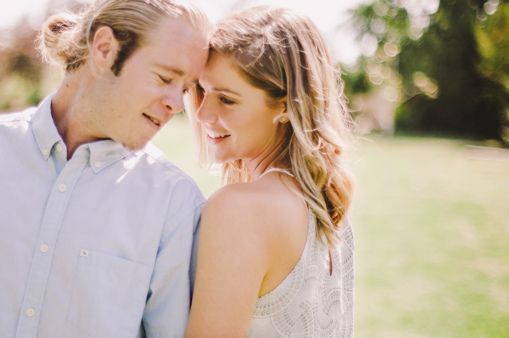 san   diego wedding photographer | blonde man in ponytail and blonde woman with   foreheads together and smiling