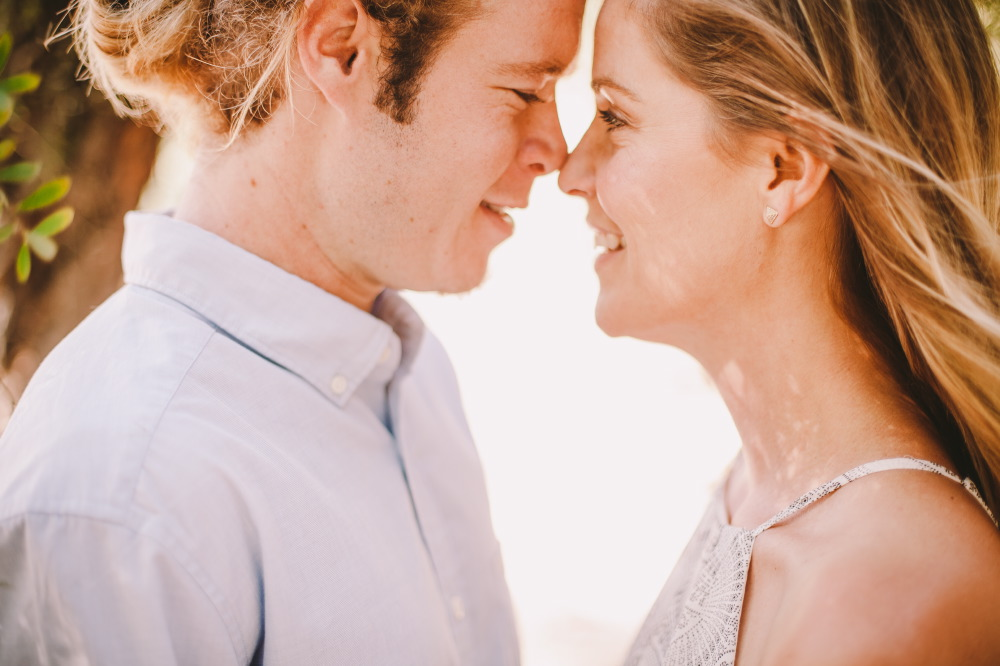 san   diego wedding photographer | close-up shot of blonde man in ponytail and   blonde woman facing each other and with noses together