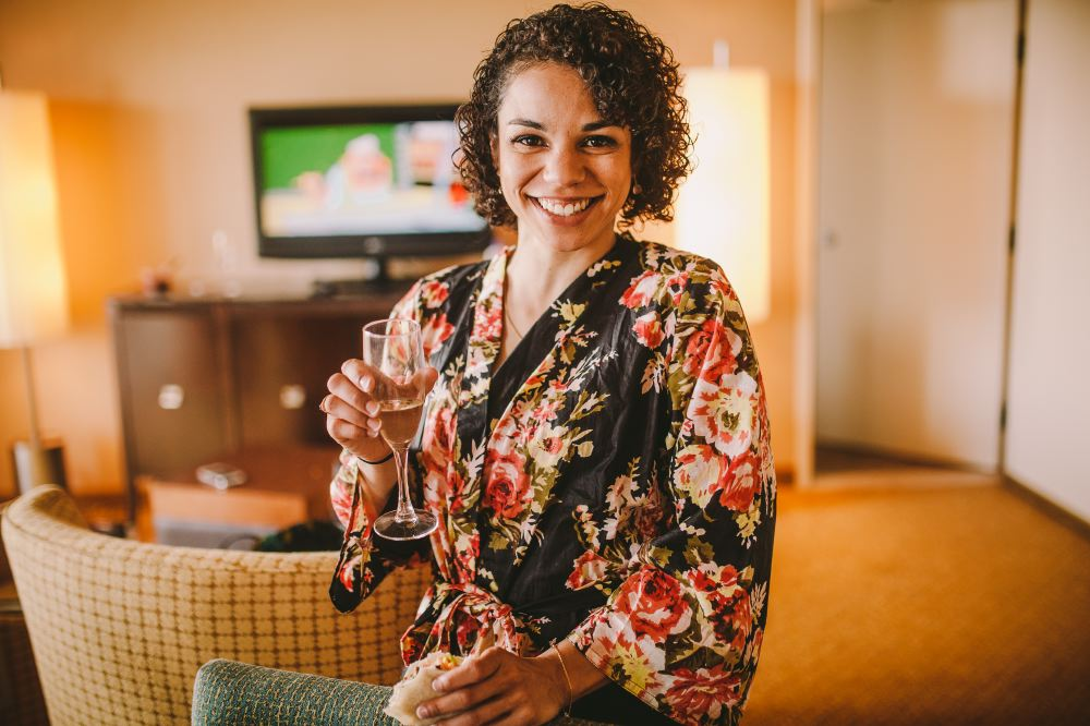 san   diego wedding photographer | woman with curly hair in a kimono holding   glass