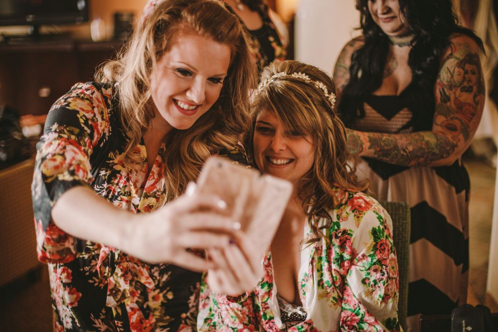 san   diego wedding photographer | women in floral kimonos taking a selfie