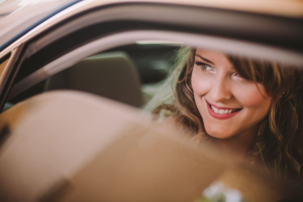 san   diego wedding photographer | bride to be peeking through car window