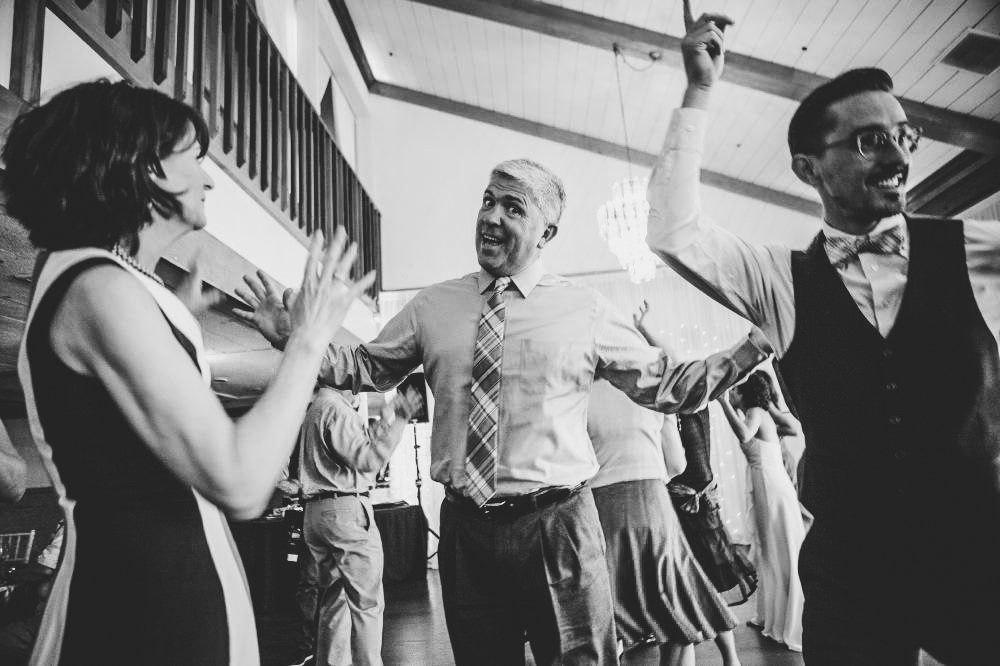 san   diego wedding photographer | monotone shot of man dancing in crowd of people