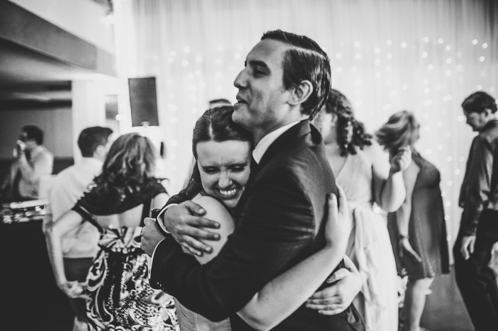 san   diego wedding photographer | man in dark suit hugging woman on dance floor