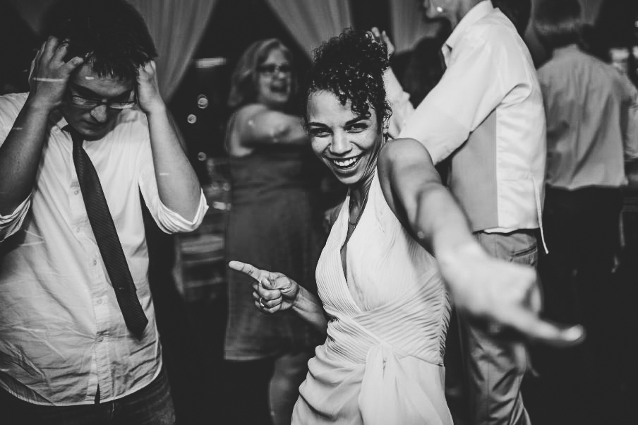 san   diego wedding photographer | woman dancing pointing at camera