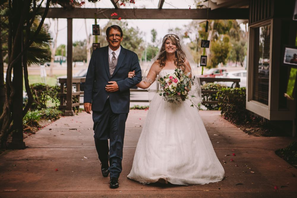 san   diego wedding photographer | bride to be with arm around her father in blue   suit