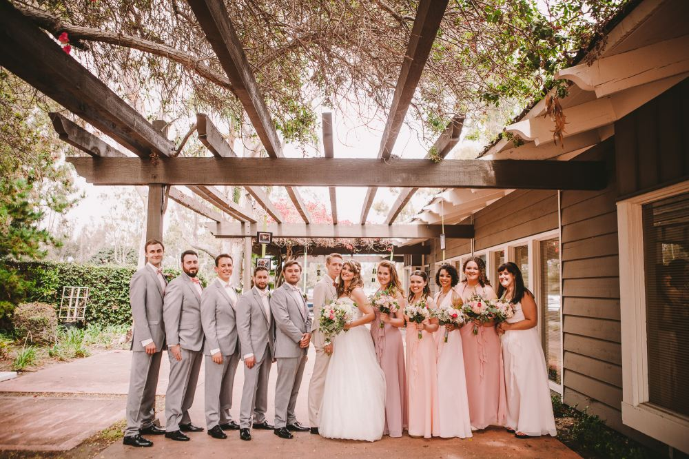 san   diego wedding photographer | groomsmen and bridesmaids lined up with bride   and groom in the middle