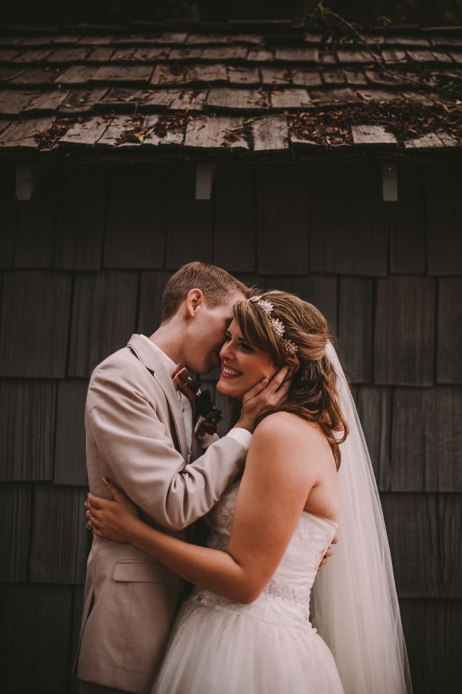 san   diego wedding photographer | newly wed couple in front of old wooden shack
