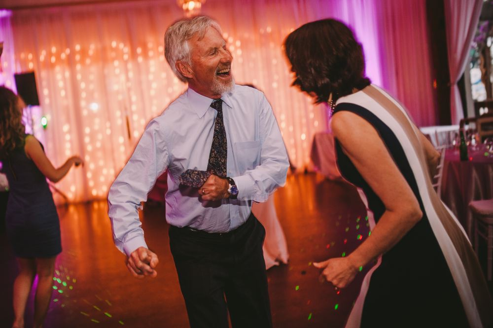 san   diego wedding photographer | old man happily dancing on dance floor