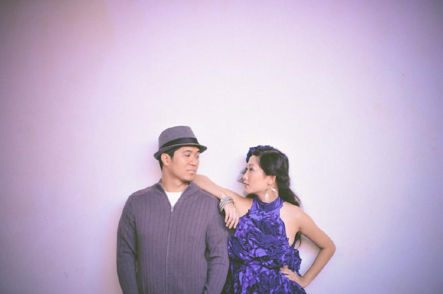 san   diego wedding photographer | woman in deep purple dress leaning elbow on man   in cardigan's shoulder