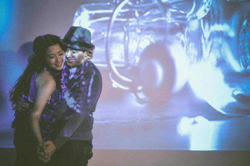 san   diego wedding photographer | woman in purple dress holding man in cardigan   and fedora