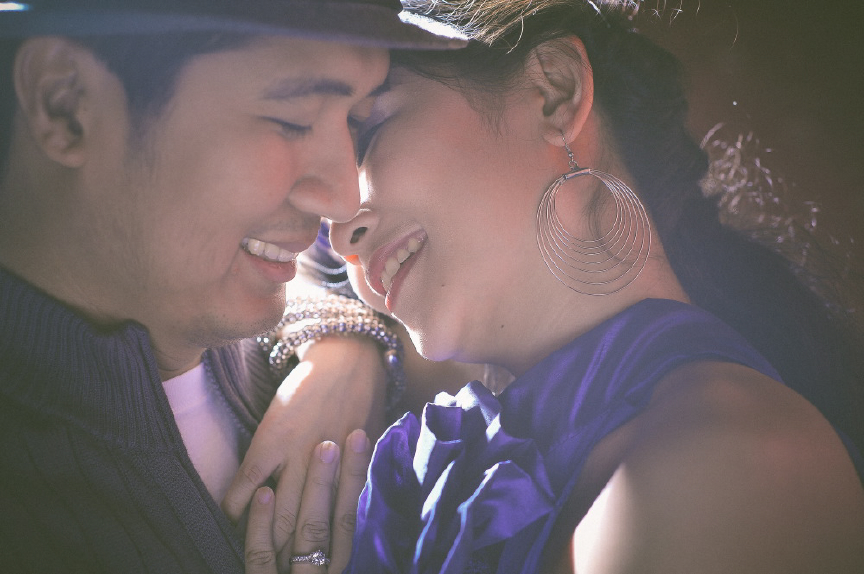 san   diego wedding photographer | man smiling close with woman with multiple hoops   earrings