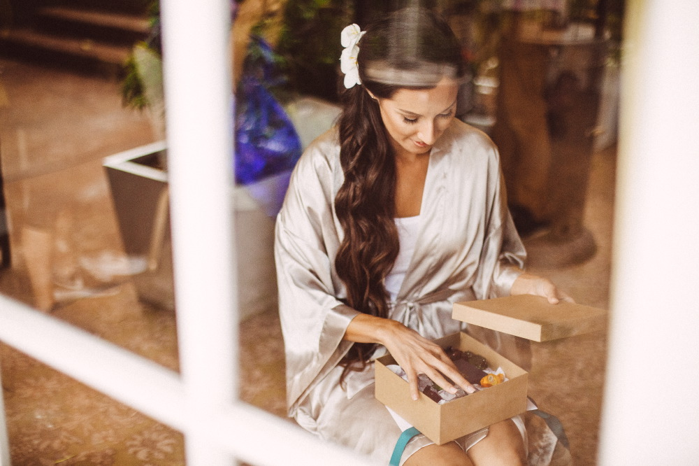 san   diego wedding photographer | bride to be looking at contents of box