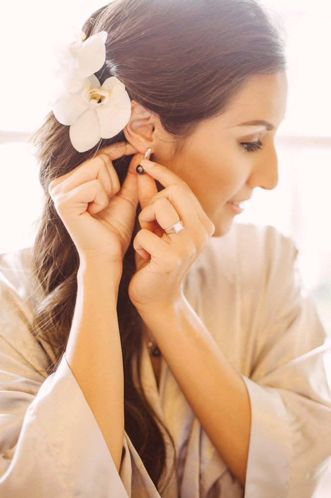 san   diego wedding photographer | bride with flowers in hair putting on earring