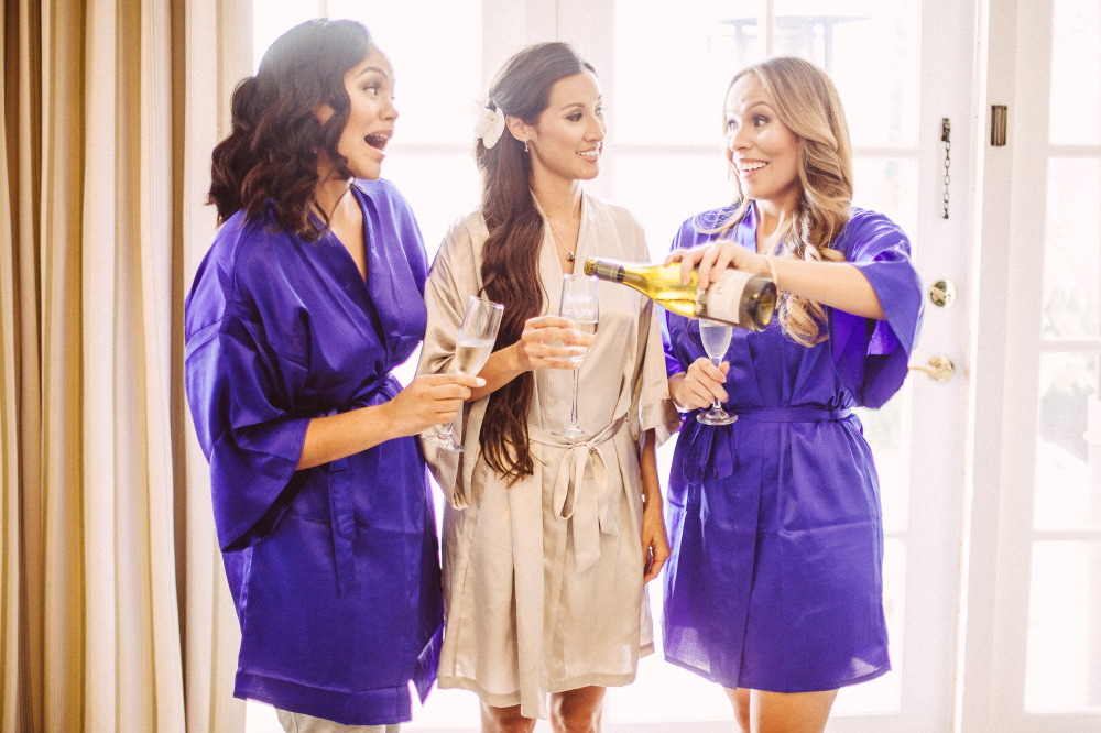 san   diego wedding photographer | bridesmaids and bride to be talking pouring   champagne