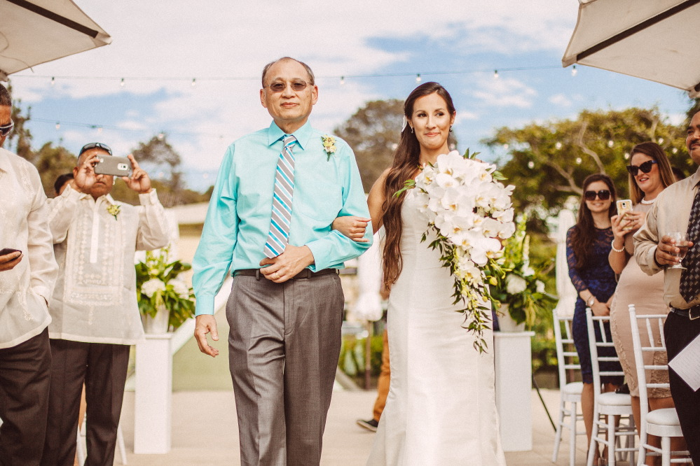 san   diego wedding photographer | bride with white flower arrangement being walked   down the aisle with her father