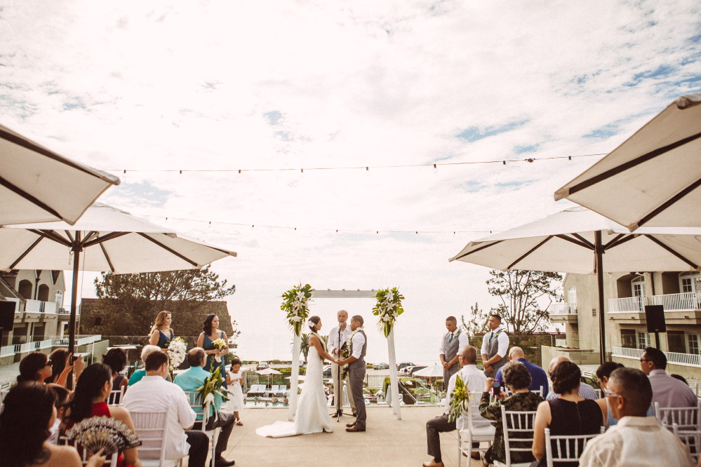 san   diego wedding photographer | slightly off center couple holding hands in   front of officiator