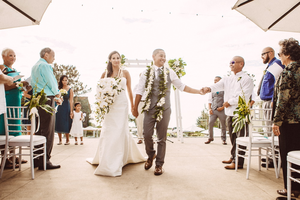 san   diego wedding photographer | newly wed couple with lay around their necks   walking up the aisle