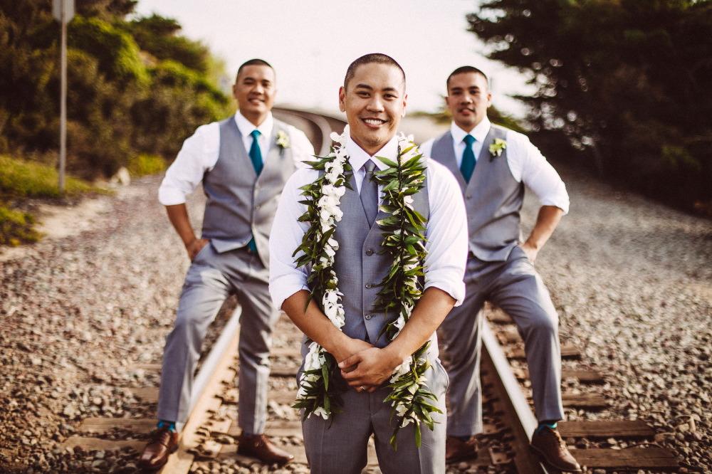san   diego wedding photographer | groom with groomsmen on railroad