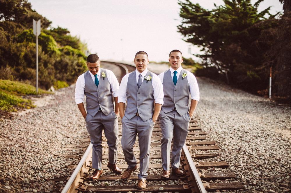 san   diego wedding photographer | groom and groomsmen walking on railroad