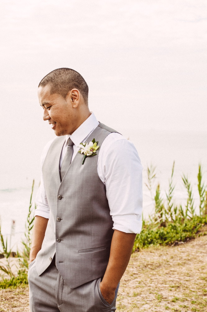 san   diego wedding photographer | groom in grey vest smiling looking down to his   side