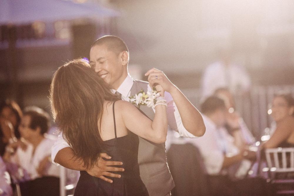 san   diego wedding photographer | groom in grey vest dancing with woman in black   dress