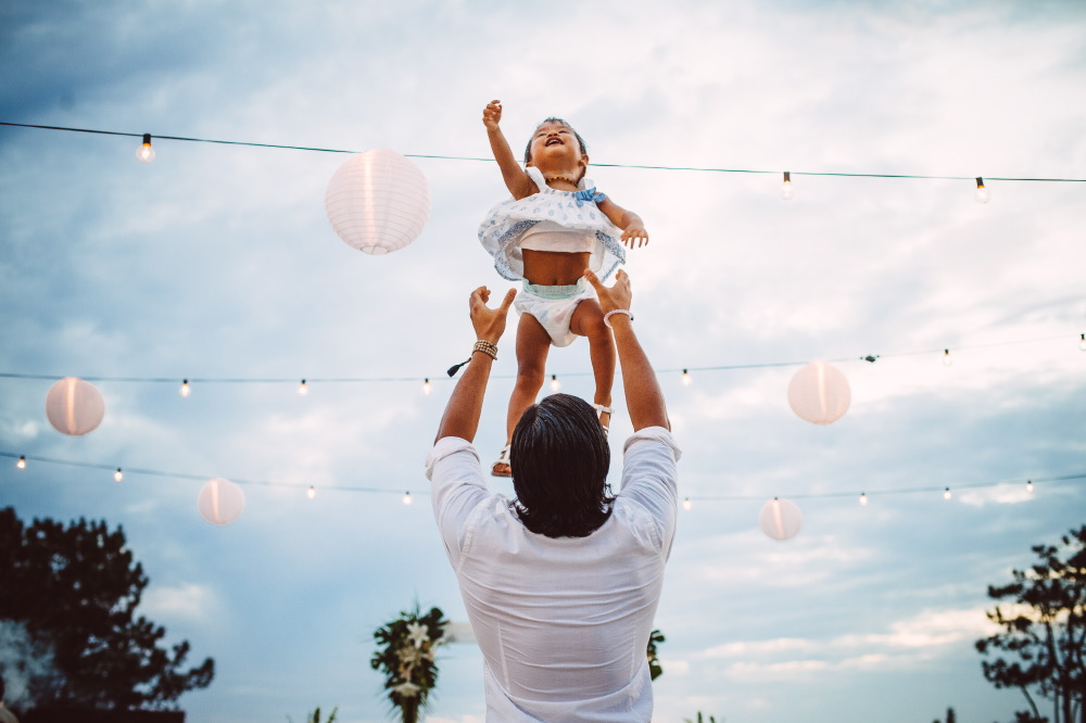san   diego wedding photographer | baby being thrown up high by man