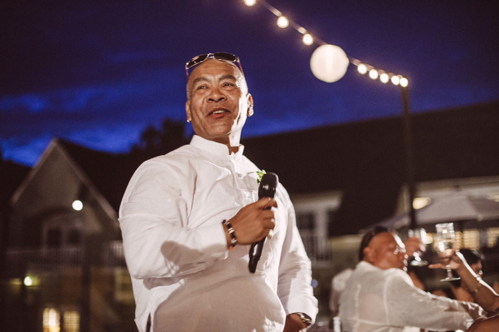 san   diego wedding photographer | man in white shirt and shades holding mic
