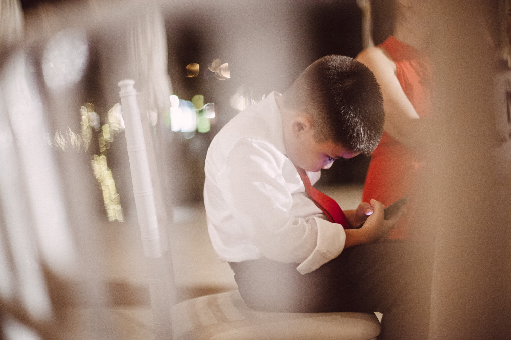 san   diego wedding photographer | child looking at phone