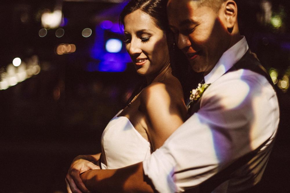 san   diego wedding photographer | groom holding bride from behind under shade