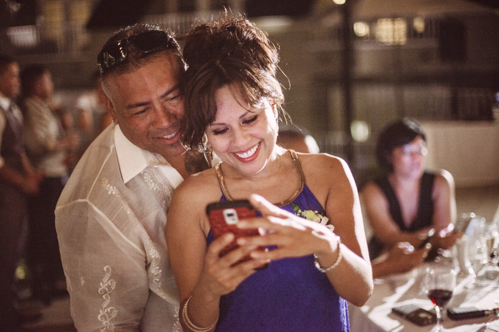 san   diego wedding photographer | woman in blue dress smiling looking at her phone