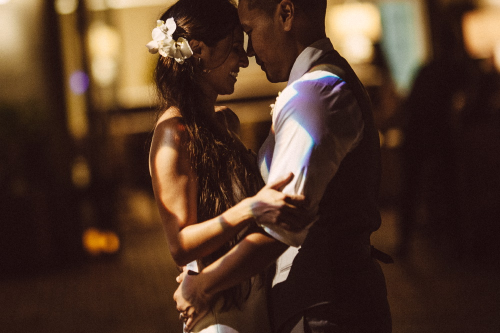 san   diego wedding photographer | groom and bride holding each other close under   shade