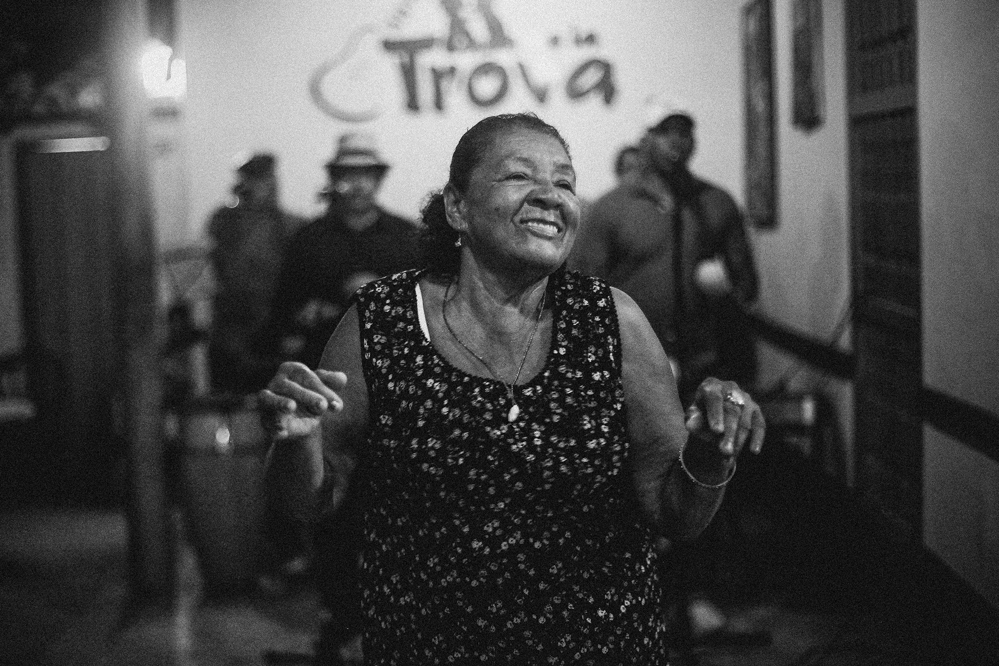 A lady dances as a band plays Salsa music in the background, Salsa is very popular in Cuba and has been part of the country's identity ever since.  Trinidad, Cuba 2013
