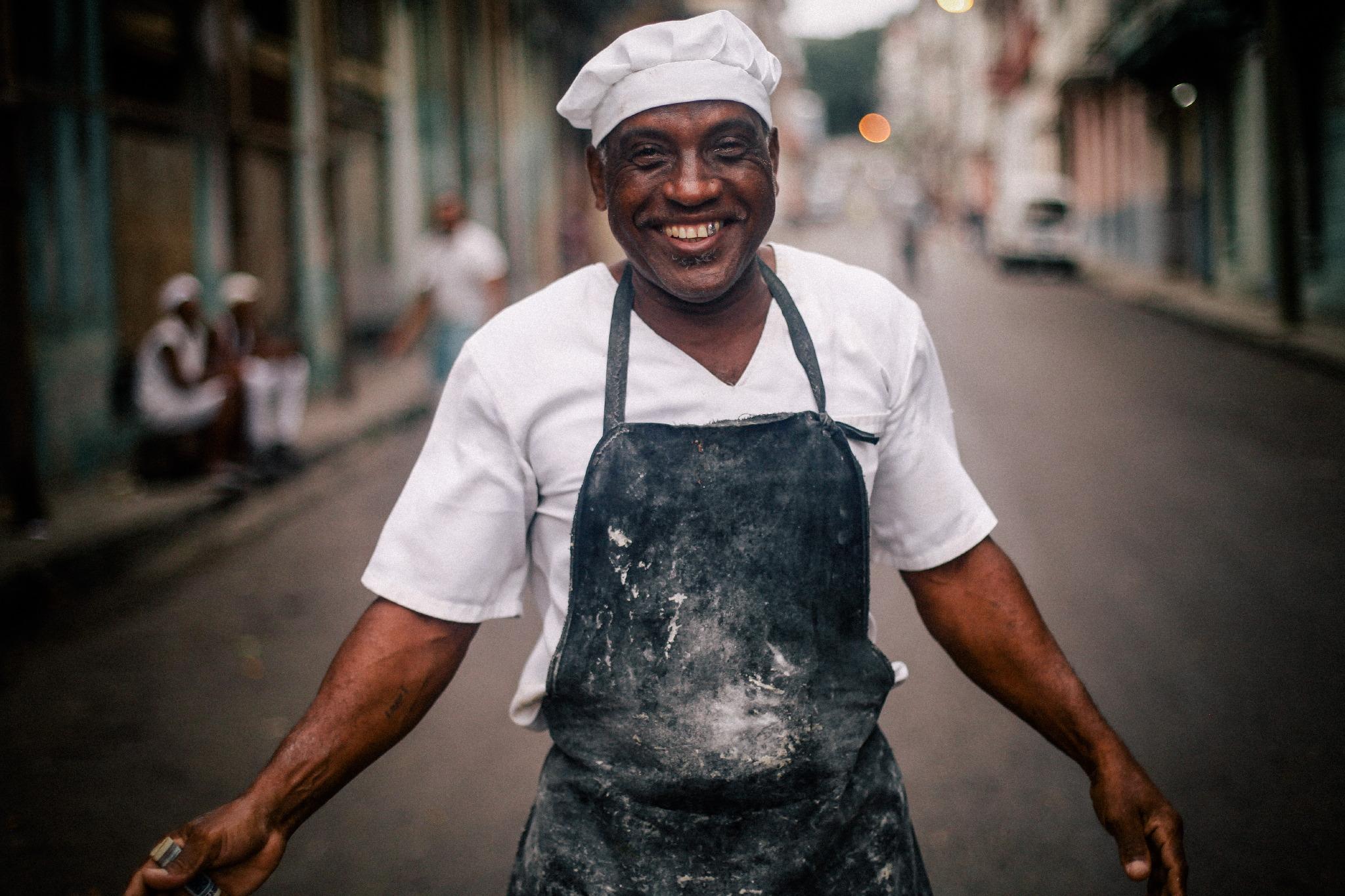 san diego wedding   photographer | baker with black apron smiling