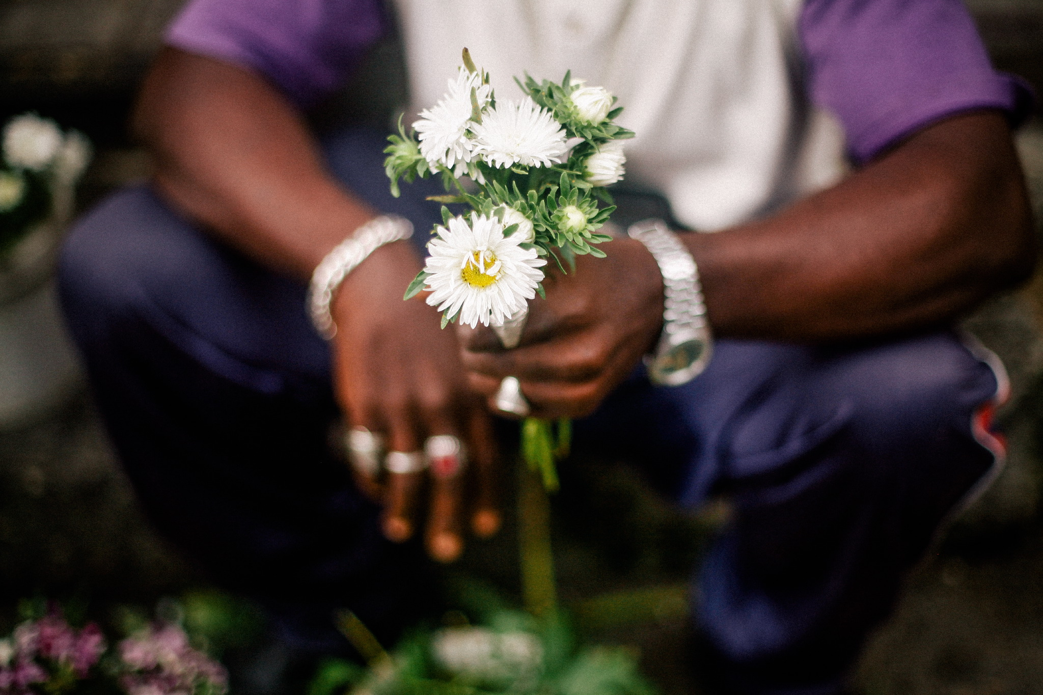 san diego wedding   photographer | person in purple clothing holding bunch of white flowers