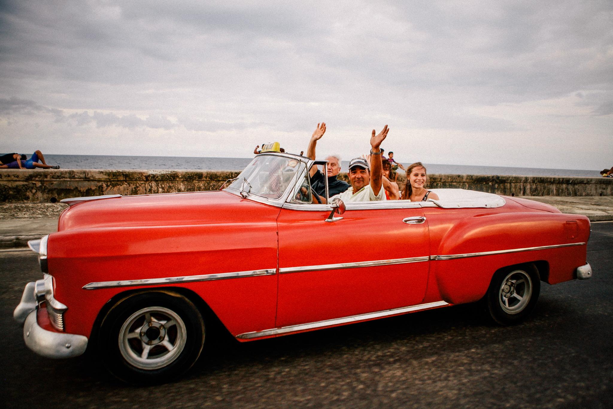 san diego wedding   photographer | people in red convertible waving hi